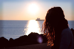into the sun (sayonara80) Tags: sun sole light luce canon photo photography woman donna lomo effect reflex red girl sea mare sunset hair sky cielo boat colors nature rocks glitter bokeh