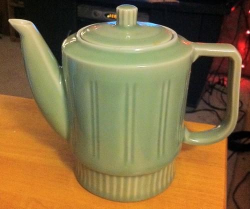 Green teapot lit