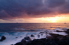 Kona Coast Sunset - [EXPLORED] (andreaskoeberl) Tags: ocean longexposure sunset sea sun beach water colors night clouds boats hawaii coast nikon rocks cloudy kona kailua kailuakona 1685 d7000 nikon1685 regionwide nikond7000 andreaskoeberl