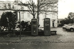 telephone boxes (johnnytakespictures) Tags: road street city red urban white black building film design boots box telephone boxes analogue coventry warwick ilford disposable singleuse hp5plus