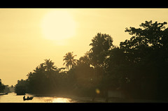 Winter memories (VinothChandar) Tags: trees winter summer sun india snow storm hot cold reflection nature sunshine weather hail yellow canon season lens boat warm december feel memories kerala hues memory lensflare flare boating 5d hue climate warming colder globalwarming warmer alapuzha