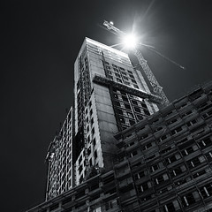 Night Shift (mbromberger) Tags: longexposure light blackandwhite bw berlin tower night concrete construction darkness crane geometry bahnhofzoo zoologischergarten citywest pentaxk10d pentaxda1645mmf4 zoofenster