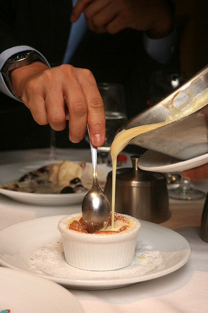 Grand Marnier Souffle - the server pours vanilla cream infused with bittersweet orange liquer