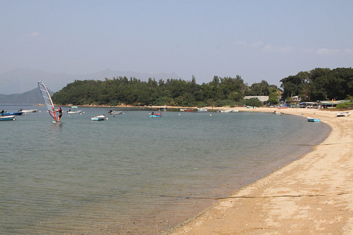 Windsurfer sets off from the beach at Wu Kai Sha
