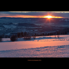 sun under the blanket (stella-mia) Tags: pink sunset orange sun snow reflection norway clouds evening lensflare eveninglight 70200mm hightlight ringsaker undertheblanket canon5dmkii veslelien annakrmcke nesandhelgya