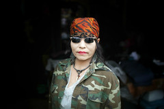 Krung Thep, the city of angels (slow paths images) Tags: asia southeastasia thailand bangkok krungthep thecityofangels chatuchak jjweekendmarket portrait woman thai asian seller pose makeup headscarf sunglasses whitecompexion militaryjacket travel fredcan pagesfredcanongephotography166659476684013