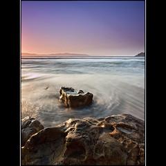 (David Panevin) Tags: longexposure morning sky bw seascape beach water clouds sunrise landscape rocks australia olympus tasmania e3 cliftonbeach sigma1020mmf456exdchsm southarm bwnd davidpanevin
