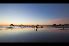 walking on the mirror (Eric 5D Mark III) Tags: california sky people cloud seascape color reflection beach canon landscape pier twilight couple walk surfer atmosphere wideangle orangecounty huntingtonbeach ef1635mmf28liiusm eos5dmarkii