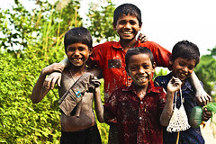 Happy Kids (Tipu Kibria~~BUSY~~) Tags: boy portrait people cute boys smile childhood kids canon children happy eos kid village child faces innocent lifestyle villagekids bangladesh canonef50mm18 xti 400d munsigonj shudhuibanglamunsigonjvromon mudarkandi