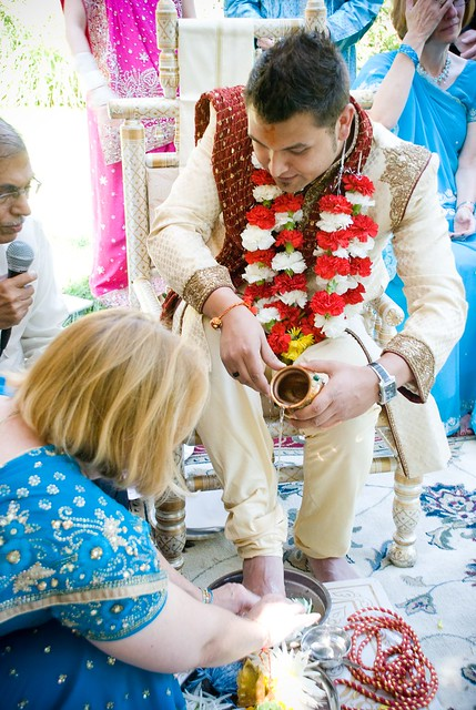 Official ceremony begins, Mom accepts Suraj into the family by washing his feet