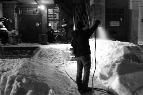 hosing down the snow berm