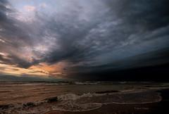 Dragging the sky (Robyn Hooz) Tags: morning sea sky cold colors rain clouds canon sand nuvole waves wind stripes sigma cielo breeze pioggia freddo comb vento onde sabbia strisce hsm pettine 1020ex widengle