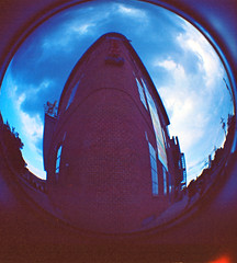 avam corner (rooftoilet) Tags: old blue sky distortion 120 film circle distorted egg machine fisheye diana