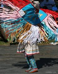 Dancer #213: One of Nine (VIM'S PLACE) Tags: blue feet colors ribbons colorful dancers dancing feathers skirt tribal nativeamerican gathering spirituality spiritual motherearth 2010 regalia moccasins powwow ribbondance councilofthreeriversamericanindiancenter