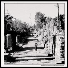The Mean Streets of Bosra (Michaelallangrant) Tags: road family blackandwhite 6x6 square blackwhite persian ruins minolta roman sony islam pillar unesco syria pillars byzantine 2010 bosra nabatean minoltalens sonydslr sonya900 michaelallangrant leigoncyrenaicaiii