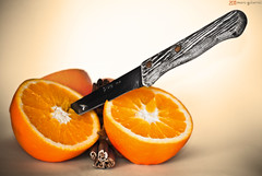 Murdered oranges. ( Mario Gutirrez Photographer) Tags: food orange house color cooking kitchen fruit dead warm soft background rustic knife scene fruta cocina naranja cuchillo clido rstico