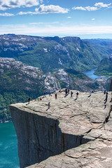 Natural High - Preikestolen/Pulpit Rock (Jim Boud) Tags: ocean sky cliff mountain norway clouds digital canon eos rebel hike atlantic adventure fjord xsi preikestolen prekestolen lysefjorden norse adjust pulpitrock 450d forsand jimboud jrbxom jamesboud