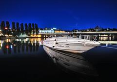 Anchored (AbhijeetVardhan) Tags: longexposure summer reflection water night nikon sweden stockholm speedboat anchor gamlastan d90 centralbro