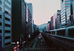 Concrete Lilac (Hayden_Williams) Tags: city urban metro train transit busy skyscrapers skyscraper buildings road cars people pedestrian street hustle night downtown taipei asia taiwan film analog analogue canonae1 fd50mmf18 lomography lomo lomochromepurplexr100400