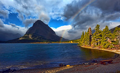 Pot of Gold (Deby Dixon) Tags: trees sunlight lake storm tourism beach nature water clouds landscape photography rainbow travels nikon dramatic stunning glaciernationalpark excitement nationalparks deby allrightsreserved 2010 swiftcurrentlake manyglacier naturephotographer debydixon grinnellmountain debydixonphotography