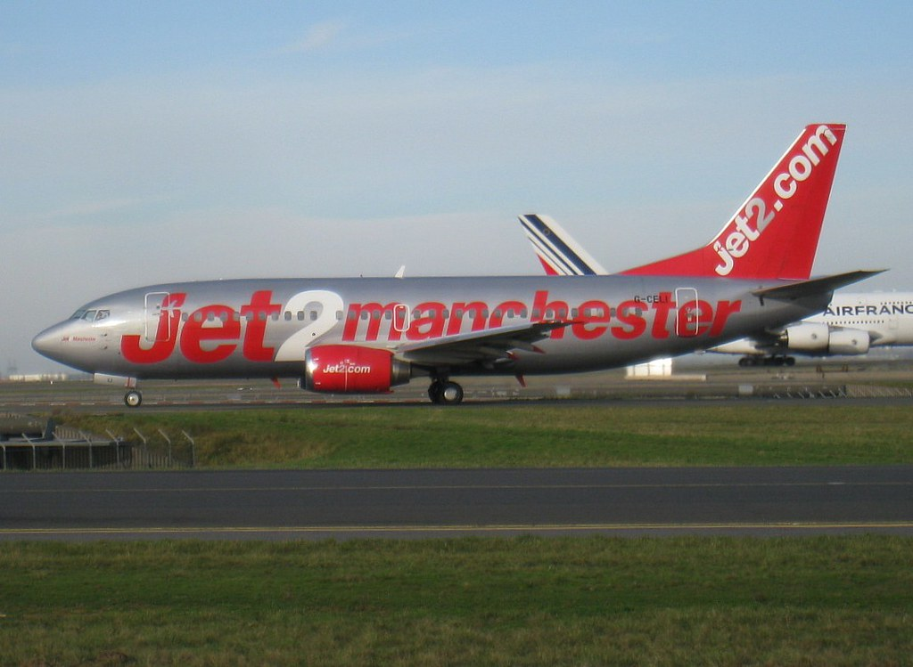 While taxying to the runway, Jet2's Boeing 737-330 G-CELI managed not to be dwarfed by the outgoing A380 on her taking-off roll hundreds of yards away