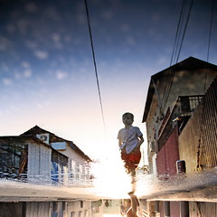 Winter Dreams (Gilad Benari) Tags: city winter boy sunset urban reflection art rain print poster square puddle israel telaviv kid different dream  gilad oster nevezedek     benari