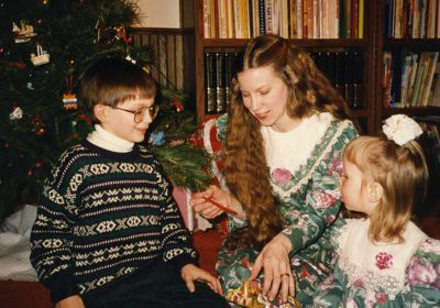 Will (7) and Christina (2) giving their ornament gifts to Deb after the Christmas Eve candlelight service, 1992.