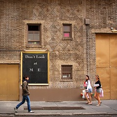Don't Look at M E (fotophriendly) Tags: nyc girls people newyork building brick guy smile composition walking square design nice funny niceshot legs sidewalk blackboard quirky watermark musictomyeyes dontlookatme supershot ©allrightsreserved mywinners anawesomeshot mycameraneverlies heartawards canon40d betterthangood goldstaraward spiritofphotography fotophriendly visionaryartsgallery absolutelyperrrfect parisinitafriends rchommel poppyawards