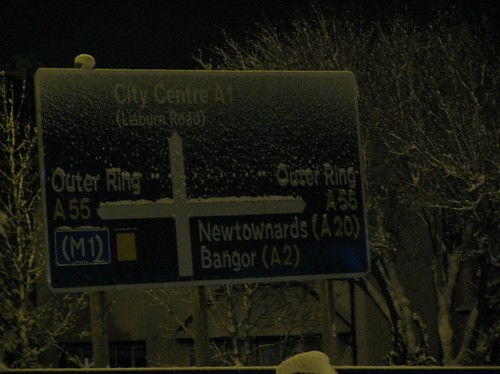 Night time snowy N.I. road sign