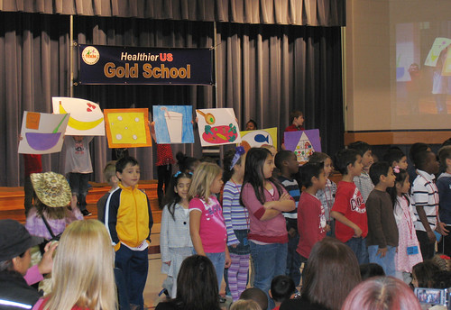 Students at Minshew Elementary School celebrated the receipt of the gold award in the HealthierUS School Challenge by singing about healthy foods.