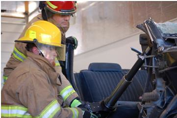 Firefighters practice with gear that helps extract auto crash victims at a new USDA funded fire station in Idaho