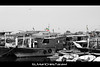 Kuwait Flags On Boats (ELManCHesTarawi) Tags: blackandwhite white black canon boats boat kuwait kuwaitcity الكويت كويت kuwaitflag بحر 550d كانون kuwaitboat kuwaitsea kuwaitflags canon550d kuwaitboats