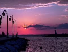 GaZiNg.............. (Ilias Orfanos) Tags: sunset sea people sun clouds landscape olympus greece gazing patras lampposts bestcapturesaoi tripleniceshot elitegalleryaoi dblringexcellence tplringexcellence