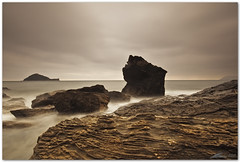 rainy day, dream away (chris frick) Tags: sea italy seascape rain sunrise dawn coast mediterranean liguria tripod wideangle boulders filter lee gitzo ballhead albenga isolagallinara rainydaydreamaway canon1635mm28lusm chrisfrick 09nd canoneos5dmark2 075gndhard