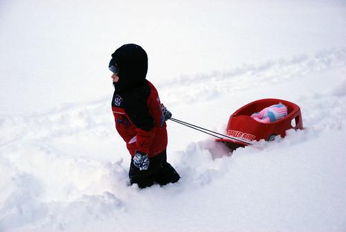 Ian pulling Annaliese's sled
