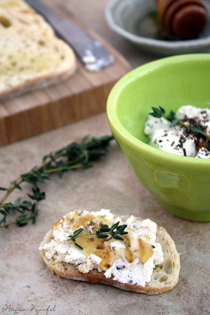 oven baked goat cheese with herbs drizzle with honey