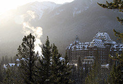 Banff Springs Hotel in the Winter Sunlight (zeesstof) Tags: trees snow canada mountains alberta banff conifers banffspringshotel wintersunlight canon7d canon18135is zeesstof fairmontbanffspings 6june1988