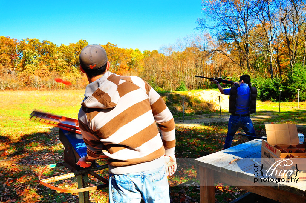 two clay pigeons being fired