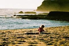 #004716 - norcal toddler at the beach, santa cruz, november 2010. (Jeff Merlet Photography) Tags: ocean leica family santacruz color film beach water rock kid xpro haze moments published fuji pacific cove crossprocess wave 400 crossprocessing 16 135 provia e6 m6 m6ttl c41 provia400x ncps scphoto r0047 elmar135 35e6co journeyofanorcalfamily jeffmerletphotography jeffmerlet photojeffmerletcom
