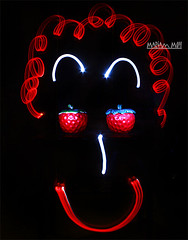 smile strawberry : ) (The stranger...) Tags: new colors face night canon painting fun happy strawberry colorful exposure paint shot drawing magic colored addicted kuwait mariam     450d      secands