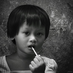 sweet candy (-clicking-) Tags: lighting light portrait blackandwhite bw cute girl monochrome childhood wall kids children square cool asia child candy faces sweet innocent vietnam squareformat innocence lovely delicate cutegirl visage nocolors sweetcandy vietnamesechildren winner500 bestportraitsaoi