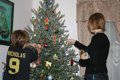 December 2010: Decorating the tree.