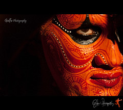 Theyyam (Gulfu) Tags: darkmaybemyrolebutrealismyemotionleenaelizabethuthup theyyam thottam portrait closeup facepainting tatto mystery humangod kerala art india kannur aluva dark smile look night thira popularhinduritual worship northmalabar baghavathi god theyyamperformer canon 1000d gulfuphotography 70200f4is gulfuin prasanthchandran