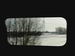 Winter slides (Moser's Maroon) Tags: trees snow tower church window train landscape canal bomen december sneeuw trein raam landschap sloot gouda woerden kerktoren haastrecht