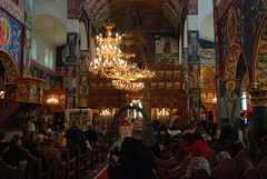 Liturgy on the Feast of the Nativity - Greek Orthodox Metropolitan Church - Abdoun, Amman, Jordan (jrozwado) Tags: christmas church asia icon jordan chandelier priest orthodox nativity metropolitan liturgy iconostas  epistle