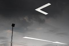 Which Directon? (danliecheng) Tags: abstract arrow carpark clouds corner dark directions lamp mysterious pole rain reflection road signs sky water white