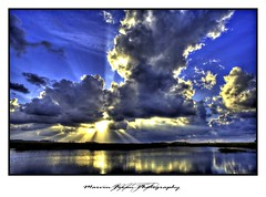 Shinning Through (Marvin Foran Photography) Tags: sun storm water clouds photoshop florida cloudy dramatic rays hdr stormyclouds stmarkslighthouse canon2470l wakullacounty stmarkswildliferefuge canon5dmkii