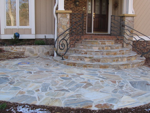 stone columns with flagstone steps and walkway on the front of a home in southwest Raleigh, North Carolina