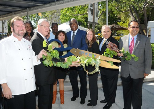 SERO Regional Administrator Don Arnette participates in a ribbon cutting ceremony with Florida officials at the Jackson Memorial Foundation Green Market celebration in honor of the farmers market now accepting SNAP EBT cards and WIC Fruit and Vegetable Vouchers, in Miami, Fla., on Dec 2.