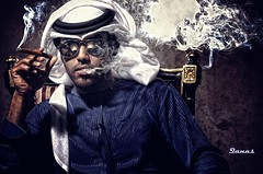 The Way I live (.Qanas.) Tags: blue glasses chair nikon hand smoke uae cigar sharp sit abu dhabi 2008 hold edit qanas 30fav asaad 20fav 40fav